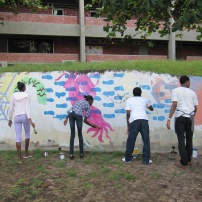Students painting a mural at BCC
