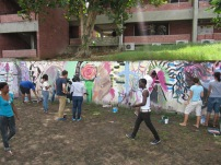 Students getting involved with the mural painting workshop