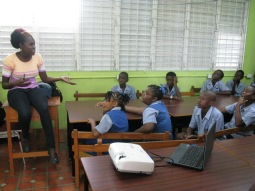 Versia addressing the Class 4 students at Workman's Primary School