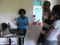 Versia showing her work to Mark King and Alicia Alleyne