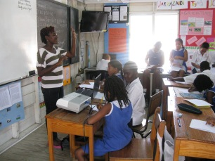 Versia Harris addresses the J4 students at St. Gabriel's Primary School