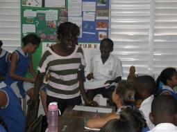 Versia talking with the students about their drawings