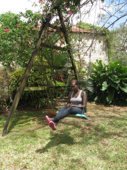 Versia sitting on the swing at Fresh Milk