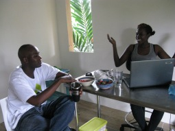 Versia speaking about her work to Aaron Kamugisha, Professor of Cultural Studies at UWI, Cave Hill Campus