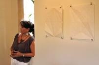 Annalee Davis next to Mark King's work on display