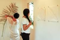 Brazilian delegates Bel Gurgel and Elisa Eisenlohr viewing the work in Fresh Milk's gallery