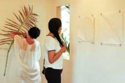 Brazilian delegates Bel Gurgel and Elisa Eisenlohr viewing the work in Fresh Milk's gallery