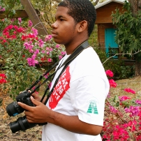 A student from the Graydon Sealy Secondary School at Fresh Milk for a photography workshop with Mark