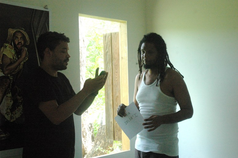 Barbadian artist Ewan Atkinson talking with Matthew Kupakwashe Murrell