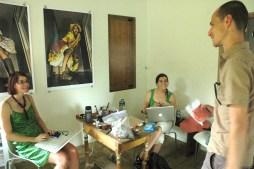 Conan and Marla talking to visiting Bahamian artist Blue Curry
