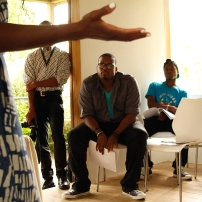 Shea addressing the Barbadian artists