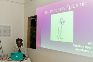 McLean Greaves presenting The Age of Infobesity. Photograph by Dondré Trotman.