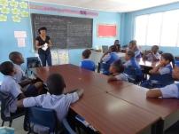 Cherise addressing the children.
