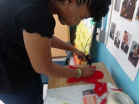 Cherise assisting with the puppet construction.