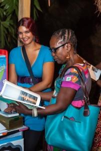 Katherine Kennedy (left) assisting at FRESH MILK XVI - Photo by Dondré Trotman.