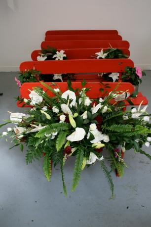 Lauren Craig, Last Offering, Installation, Wooden Beach + Funeral Wreath Flowers, 14ft x 8ft (2010)