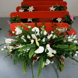 Lauren Craig, Last Offering, Installation, Wooden Beach + Funeral Wreath Flowers, 14ft x 8ft (2010)