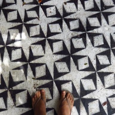 Jordan Clarke standing by Mark King's 'Untitled Grid Fields'