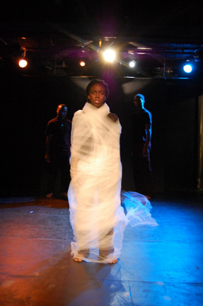 Photograph from OUTCRY, written by Thais Francis, as performed at the Red Room, NY. Image sourced from the play's official website.