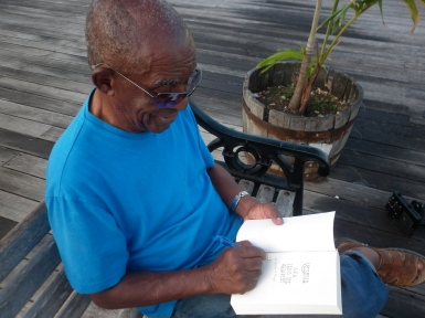 Microbiologist and acclaimed author, Alvin Cummins, signing his book, 'Yeshua: aka Jesus the Nazarene'.