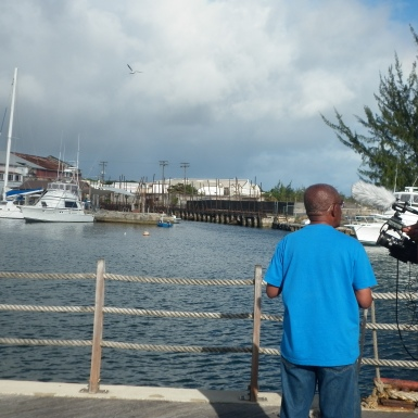 Filmmaker Powys Dewhurst and microbiologist Alvin Cummins on the boardwalk discussing the Bridgetown Dry Dock.