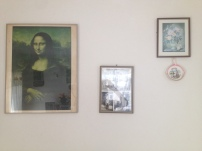 Photographs on the wall of Rayanne's family's home