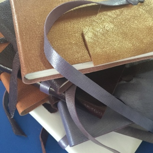 Leather books created by workshop participants