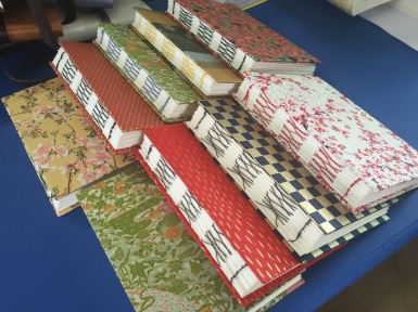 Exposed spine books created by workshop participants