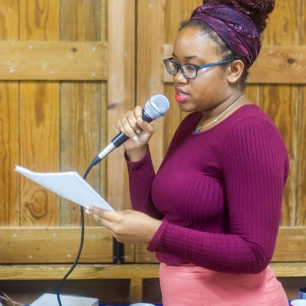 Letitia Pratt reading her poetry at FRESH MILK XXI. Photo by Dondré Trotman