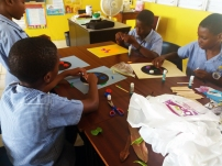 Ronald Williams leading a collage workshop at Workmans Primary School
