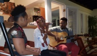 Adaeze performing at Dr. Clyde Cave's house