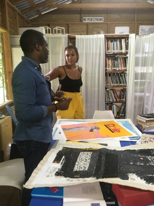 Kraig Yearwood in discussion with curator Aliyah Hasinah