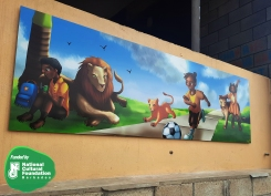 Work by Mohita Shenoy on a mural at St. George Primary School